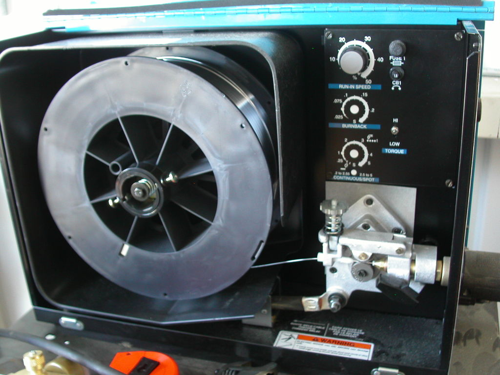 The inside of a MIG / wire feed welder